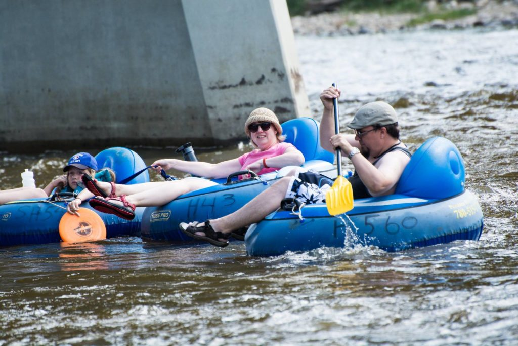 People floating on tubes down a river
